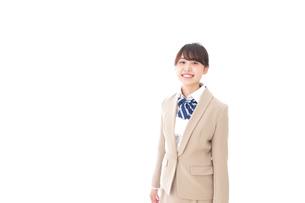 制服を着た笑顔の学生の写真素材 [FYI04709439]