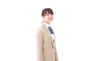 制服を着た笑顔の学生の写真素材 [FYI04709451]