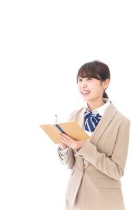 ノートを取る学生の写真素材 [FYI04709509]