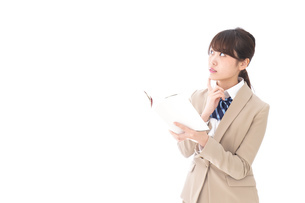 読書をする制服姿の学生の写真素材 [FYI04709510]