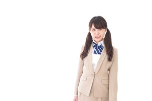 制服を着た笑顔の学生の写真素材 [FYI04709515]