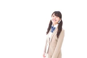 制服を着た笑顔の学生の写真素材 [FYI04709519]