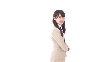 制服を着た笑顔の学生の写真素材 [FYI04709530]