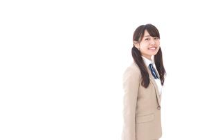 制服を着た笑顔の学生の写真素材 [FYI04709531]