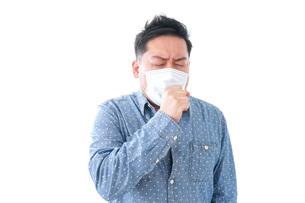 風邪をひいた男性の写真素材 [FYI04709844]