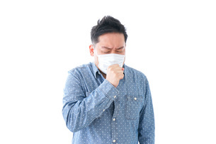風邪をひいた男性の写真素材 [FYI04709849]