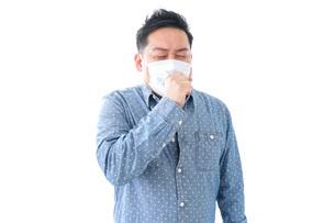 風邪をひいた男性の写真素材 [FYI04709850]