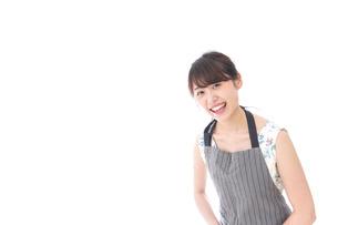 おじぎをするカフェの店員・おもてなしの写真素材 [FYI04711535]