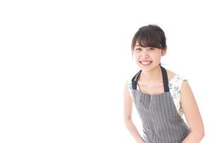 おじぎをするカフェの店員・おもてなしの写真素材 [FYI04711540]