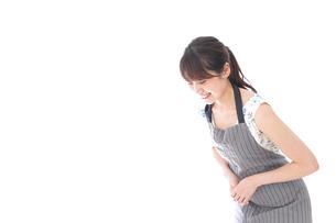 おじぎをするカフェの店員・おもてなしの写真素材 [FYI04711559]