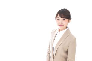 笑顔のビジネスウーマン・おもてなしの写真素材 [FYI04711568]