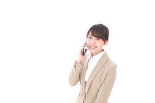 電話でコミュニケーションするビジネスウーマンの写真素材 [FYI04711862]