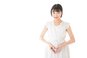 妊娠した若い女性の写真素材 [FYI04711928]
