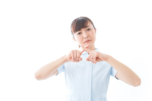 NOを示す若い看護師の写真素材 [FYI04713169]