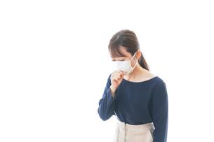 咳の症状がある若いビジネスウーマンの写真素材 [FYI04714078]