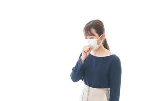 咳の症状がある若いビジネスウーマンの写真素材 [FYI04714087]