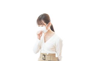 肺炎に感染した若いビジネスウーマンの写真素材 [FYI04714313]