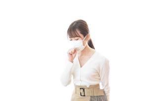 肺炎に感染した若いビジネスウーマンの写真素材 [FYI04714314]