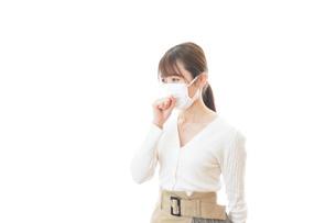 肺炎に感染した若いビジネスウーマンの写真素材 [FYI04714315]
