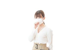 肺炎に感染した若いビジネスウーマンの写真素材 [FYI04714316]