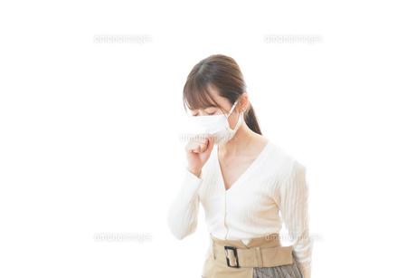 肺炎に感染した若いビジネスウーマンの写真素材 [FYI04714317]