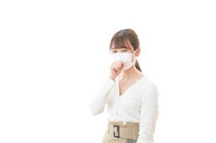 肺炎に感染した若いビジネスウーマンの写真素材 [FYI04714327]