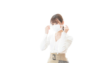 マスクをした若い女性の写真素材 [FYI04714328]