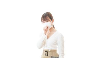 肺炎に感染した若いビジネスウーマンの写真素材 [FYI04714329]