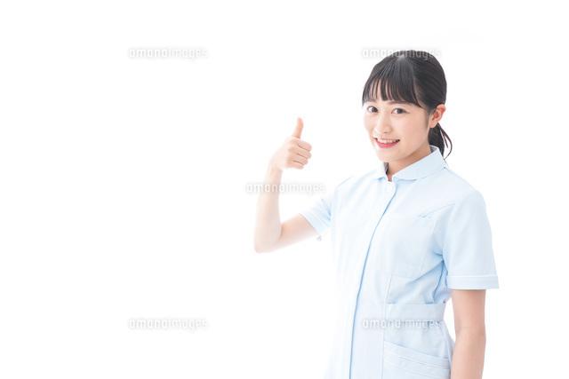 OKサインをする若い看護師の写真素材 [FYI04714846]