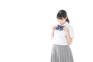 制服姿の女子学生ポートレートの写真素材 [FYI04715229]
