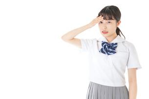頭痛に苦しむ若い女子学生の写真素材 [FYI04715904]