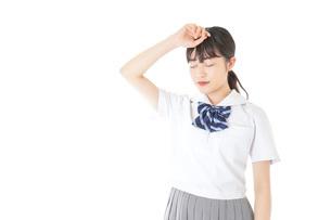 頭痛に苦しむ若い女子学生の写真素材 [FYI04715922]