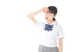 頭痛に苦しむ若い女子学生の写真素材 [FYI04715923]