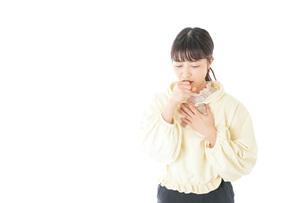 喉の痛みに苦しむ若い女性の写真素材 [FYI04716151]