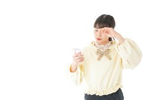 熱に苦しむ若い女性の写真素材 [FYI04716152]
