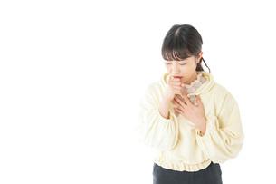 喉の痛みに苦しむ若い女性の写真素材 [FYI04716157]