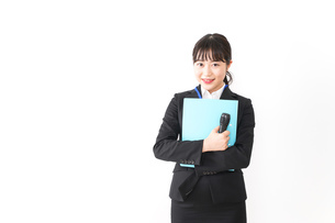 プレゼンテーションをする若いビジネスウーマン 営業イメージの写真素材 [FYI04718016]