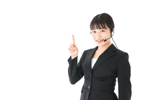若い女性オペレーター・同時通訳イメージの写真素材 [FYI04718559]