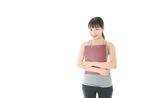 スポーツウェアを着た若い女性の写真素材 [FYI04720808]