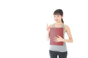 スポーツウェアを着た若い女性の写真素材 [FYI04720822]