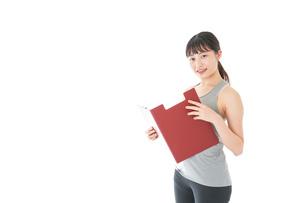 スポーツウェアを着た若い女性の写真素材 [FYI04720842]