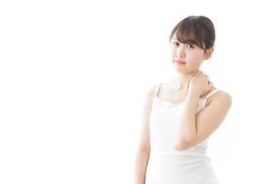 肩こり・関節痛に悩む女性の写真素材 [FYI04721884]
