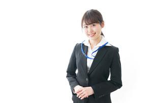 笑顔のビジネスパーソン・受付嬢の写真素材 [FYI04723338]