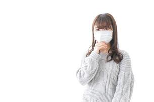 風邪をひいた女性の写真素材 [FYI04723436]
