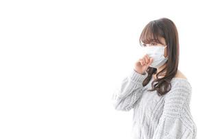 風邪をひいた女性の写真素材 [FYI04723440]