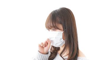 風邪をひいた女性の写真素材 [FYI04723456]