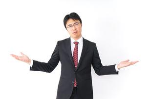 疑問・理解不能・ビジネスマンの写真素材 [FYI04724209]