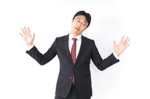 疑問・理解不能・ビジネスマンの写真素材 [FYI04724215]