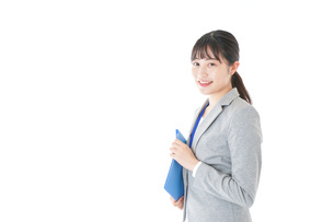 オフィスで働く若いビジネスウーマンの写真素材 [FYI04726740]