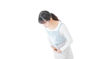 おじぎをする若い主婦の写真素材 [FYI04727820]